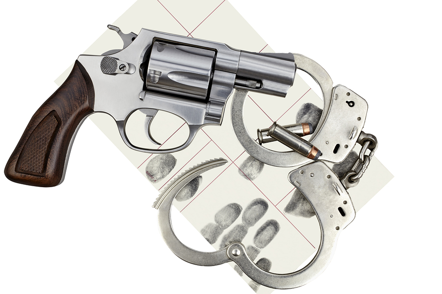 bigstock_Gun_With_Handcuffs_And_Fingerp_94532111.jpg